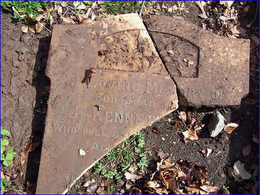 L Cpl. William Oswyn Hill's headstone before restoration